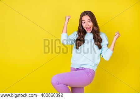 Photo Of Pretty Lovely Crazy Young Girl Raise Fists Knee Ecstatic Pose Open Mouth Win Cinema Tickets