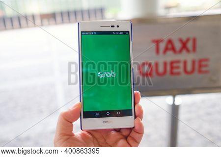 Kuala Lumpur, Malaysia - July 17, 2018. Grab Application Display On Mobile Screen (huewei P7 Smartph