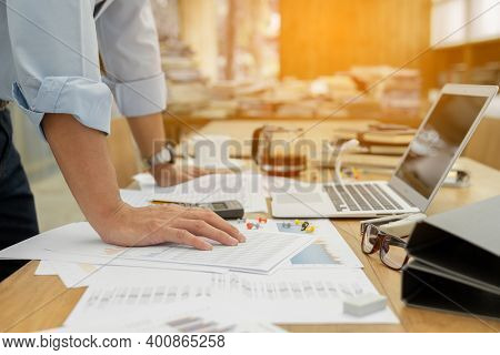 Close Up Of Male Hand On Table. Businessman Standing Near Table, Leaning His Hands On Table.