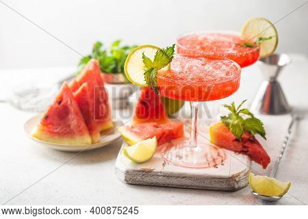 Watermelon Frozen Cocktail Margarita With Fresh Watermelon, Lime And Mint On White Background