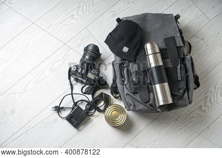 Preparing For Hiking Adventures. Outing Into Nature Concept. Background With Backpack, Thermos, Phot