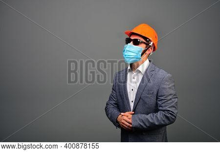 Real Estate Investor Businessman In A Medical Face Mask For Covid Prevention.