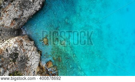 Aerial. Sea Water And Shore Rocks Texture Background. Top View From Drone.