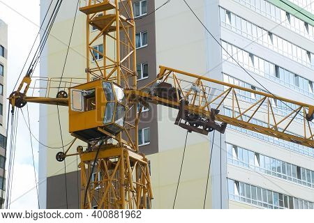 Tower Crane On A Construction Site At High-rise Building, Closeup View. Construction Of Residential