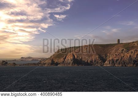 Rugged Shoreline And Mountain Side Cliffs In Guernsey, One Of The Channel Islands In The English Cha