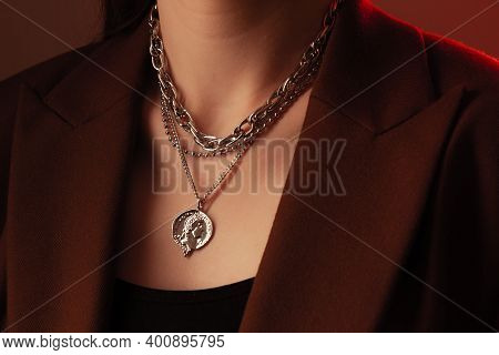 Cropped Close Up Portrait Of Young Woman With Perfect Silky Skin, Demonstrating Silver Jewelry Chain
