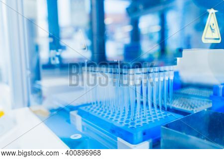 Robotics Technology Background. Blue 96 Well Roboter Head In Genetics And Medical Laboratory. Medica
