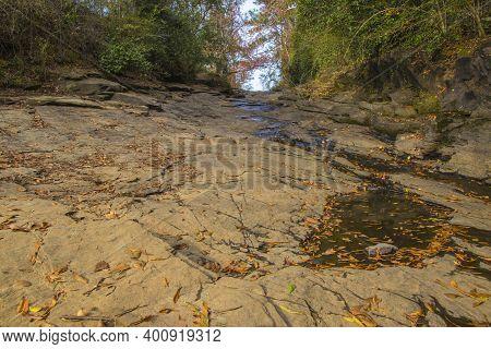Augusta, Ga Usa - 12 12 20: Augusta Canal Trail A Rock Slab Path Up A Hill