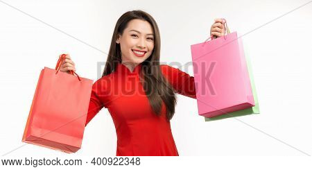 Cheerful Young Girl Wearing Vietnamese Traditional Dressing Carrying Colorful Shopping Bags