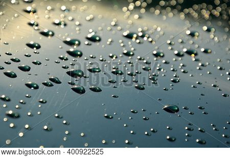Water Drops On Green Metallic Paint On The Wet Hood Of A Car. You Can't Buy Very Beautiful Reflectio