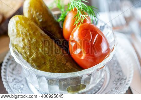 Salted Marinated Cucumbers And Tomatoes With Dill In The Transparent Glass Bowl. Delicious Tradition