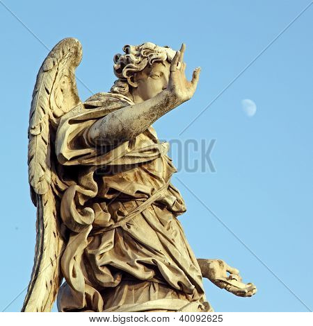 Bronze Statue Of An Angel, In Rome, With A Pale Moon In The Sky