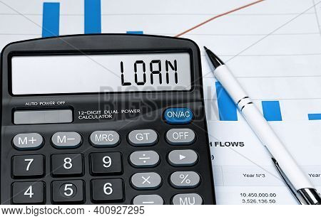 Calculator With The Word Loan On The Display. Money, Finance And Business Concept