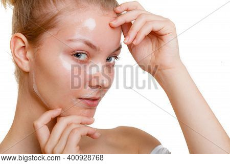 Young Woman In Facial Peel Off Mask. Peeling. Beauty And Skin Care. Studio Shot On White Background