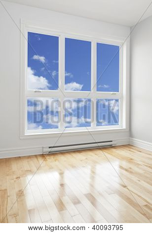 Empty Room And Blue Sky Seen Through The Window