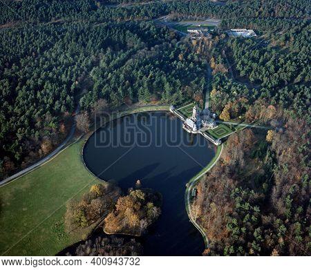 Hoenderloo, Holland, November 12 - 1986: Historical aerial photo of the Jachthuis Sint Hubertus, in the Nationale Park De Hoge Veluwe, Hoenderloo, Holland