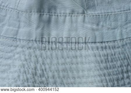 White Gray Fabric Texture From A Piece Of Crumpled Clothing With A Pattern