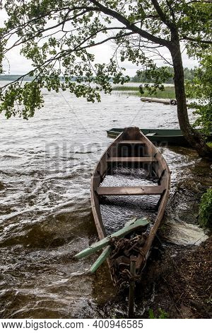 Wooden Rowing Boat On The Shore Of A Lake.  Tranquil Scene On The Baluosas Lake In Suminai Ethnograp