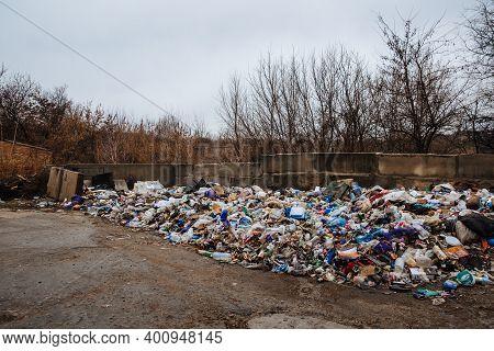 Dneprorudnoe, Ukraine - January 29 2020:garbage Dump On The Grass Near The Forest. Ecological Disast