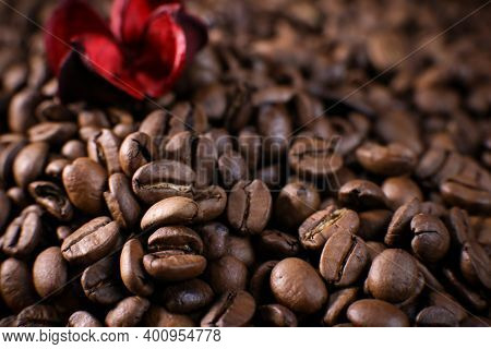 Coffee Beans Close Up Against The Background Of A Coffee Beans. Morning Espresso. Coffee Mug.