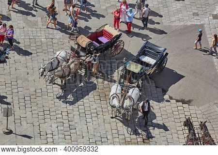 Vianna, Austria - Circa 2017: Horse carriage waiting for tourists, offering sightseeing rides in the historic center of Vianna