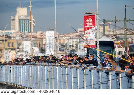 Istanbul, Turkey - 9 December 2020: Fishermans On Galata Bridge, Istanbul