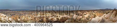 Landscape View Of Unesco World Heritage, Cappadocia, Turkey Under Cloudy Sky