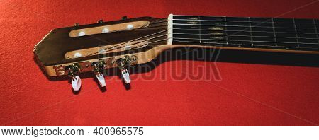 Guitar Headstock With Tuning Pegs . Color Background