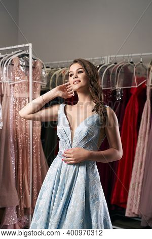 Young Beautiful Brunette Girl Wearing A Full-length Draped Sky Blue Satin Slit Prom Ball Gown Decora