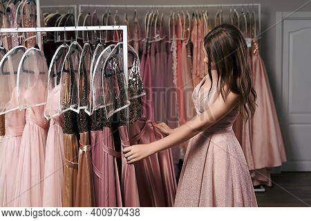 Portrait Of Young Beautiful Girl Wearing A Full-length Pale Pink Glitter Chiffon Draped Prom Ball Go