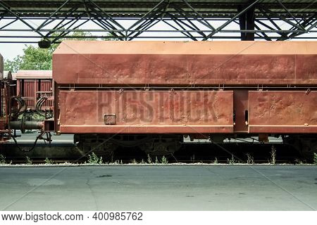 Open Hopper Car Wagon On Standby At The Platform Of A Train Station In A Cargo Train Shipping Nickel