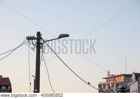 Old Street Lamp, With A Power Supply Cable, Made Of An Obsolete Connection System To The Public Netw