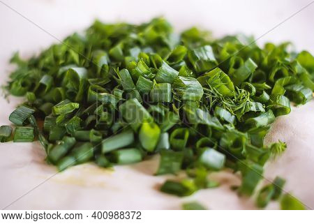 A Bunch Of Fresh Green Onion Slices In Close-up. Chopped Green, Raw Onion. Chopped Spring Onion Youn