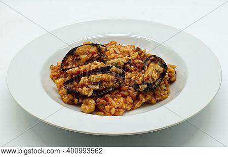 Risotto With Seafood. Risotto Ai Frutti Di Mare, Isolated On White Background