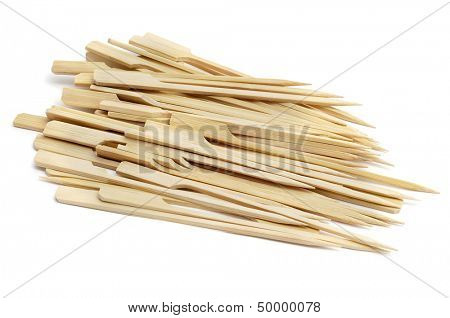 a pile of bamboo skewers on a white background