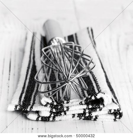 Wire whisk over kitchen cloth.