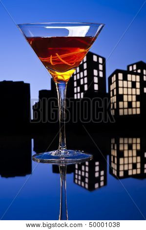 Metropolis Manhattan Cocktail In City Skyline Setting