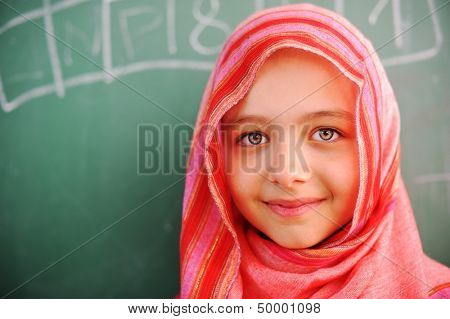 Cute lovely Arabic school children at classroom having education activities