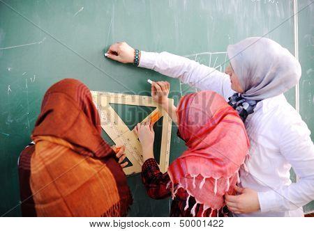 Cute lovely Arabic school children at clasroom having education activities