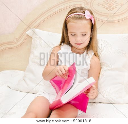 Cute Little Girl Reading A Book