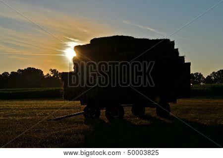 a loaded rack of alfalfa hay bales