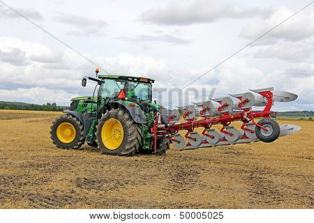 John Deere Tractor And Agrolux Plow