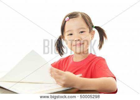 Little girl studying at the desk