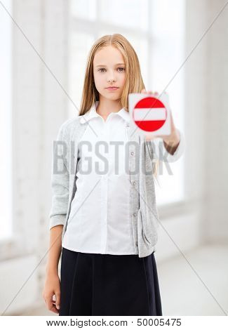 education, school and anti-bullying concept - student girl showing stop sign