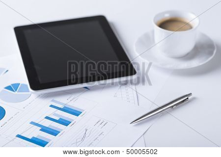 business and technology concept - tablet pc with cup of coffee