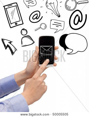 technology, internet and application concept - hand holding smartphone with email icon and doodles