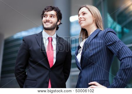 Portrait of young business people looking to the future