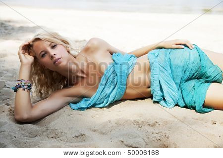 young adult sensuality attractive pretty blonde woman in blue dress bikini on the beach
