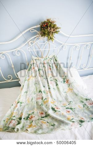 skirt and flowers are on a bed