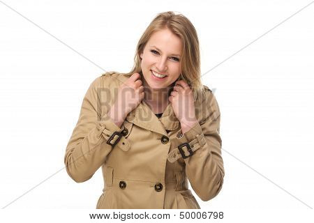 Portrait Of A Happy Young Woman In Winter Coat